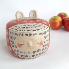 Lidded art vessel, hairy bear with a red floral scarf and rosey red cheeks