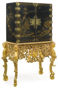 A William and Mary Parcel-Gilt, Black Japan-ned, Cabinet on Later Giltwood Stand.  Circa 1690