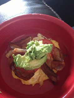 Low carb breakfast one fried egg topped with tablespoon of cream cheese two slices tomato two slices bacon and 1/4 avocado taste amazing!