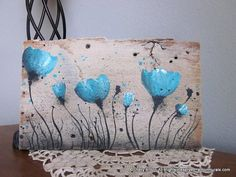 A turquoise poppies picture hand painted on a piece of old barn wood. The board is very rustic and left in its original state with no sanding.   This old board measures approx. 10 inches x 6 inches. It is sealed for protection with a hanger on the back.