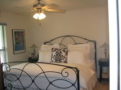 Black Iron Bed with White linens. Guest room 1