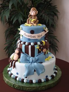 I made this cake for my baby shower. Inspired by a cake I saw here in cake central but it was the monkey girl theme. I made the same cake but for a boy.