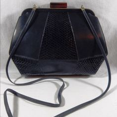 Salvatori Ferragamo - AUTHENTIC vintage handbag Gorgeous black handbag with a Lucite clasp. The certificate of authenticity is included Salvatori Ferragamo Bags Shoulder Bags