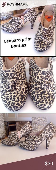 "Cute Lepoard print bootie Shoes are in a muted lepoard print fabric in black, tan & khaki. Front/top of shoe has a cool twist-tie design for added interest. Zip on the interior side of shoes. Tiny hidden platform of approx 1/4"" w/ overall heel height of 3 3/4"", so very comfy! Great condition except bottom sole shows a bit of wear as they were worn about 3x. Size says 7 but run small these are more like a 6 1/2 Rocket Dog Shoes Ankle Boots & Booties"