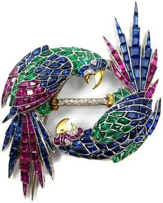 Art Deco diamond and gem-set parrot brooch with tutti-fruitti gems (calibre sapphires, diamonds, and rubies), circa 1935. Parrots detach and may be worn separately. Via Diamonds in the Library.