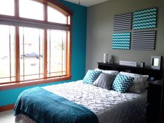 My new room. Turquoise  Grey Chevron Bedroom. Turquoise accent wall. DIY fabric covered canvases.