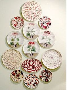 Whimsical plates ... xhttp://www.ehow.com/how_5492375_arrange-decorative-plates.html