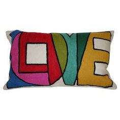 "Hand-embroidered pillow.   Product: PillowConstruction Material: FabricColor: MultiFeatures:  Hand-embroideredPerfect accent to any décor Insert includedDimensions: 12"" x 20""  Cleaning and Care: Spot clean"