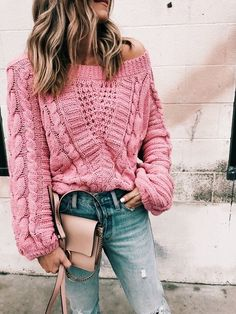 Pretty pink oversized sweater with blue jeans.