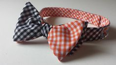 Don't you love our Black and Orange Gingham Bow Tie? Get in the Halloween Spirit!