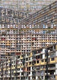This is the vertical slums in Venezuela. These slums were built for efficiency and created cheaply in order to save money. Architecture and design is not taken into account here. Is it possible to mix design and slums? Slums, Urban Landscape, Abandoned Places, South America, Central America, Places To See, Beautiful Places, Scenery, Around The Worlds