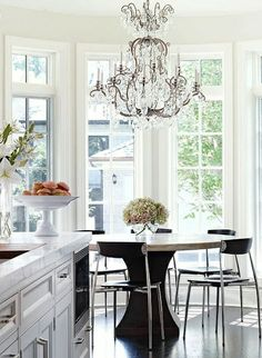 Clean and simple breakfast room with a big splash of bling. Via South Shore Decorating Blog