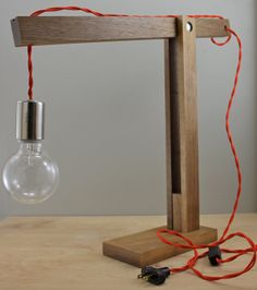 """The """"Catapult"""" Modern Wood Arm Lamp in Walnut - Contemporary Light Fixture Articulating Wooden Table Lamp - Reading Desk Task Gift. $240,00, via Etsy."""