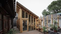 Hutong Filter is a studio added to a house in one of Beijing's traditional hutongs by architecture office Zai with pixel-style shingles and timber frames connecting to a communal courtyard. Architecture Courtyard, China Architecture, Architecture Office, Lounge Design, Architect Design, Interior And Exterior, Backyard, Timber Frames, Outdoor Decor