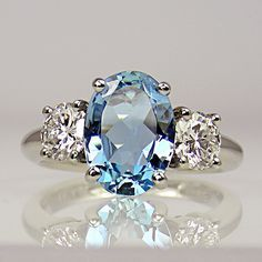 Oval aquamarine & two brilliant cut diamonds