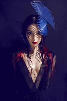 Love the hairpiece- blue chinese fan and red lips
