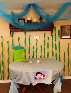 Under the Sea birthday -- blue net on ceiling and twisted crape paper seaweed on walls. Cute!