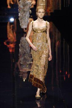 10. Dolce & Gabbana Fall 2006. Round neckline, empire waist, looks like the high stomacher dress. Empire Period.