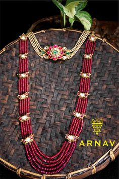 Beautiful ruby haaram in multi strands with line edgy design.<br>Pearls neckpeice with burma ruby studded flower design. 03 February 2018