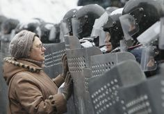 A woman addresses Ukrainian Interior Ministry members who lined up during clashes with pro-European protesters in Kiev, on January 22, 2014....