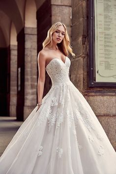 Eddy K Milano Style MD217.   Sweetheart, Tulle, Sleeveless, Ball Gown.  Colors:  Ivory / Ivory. Champagne / Ivory.         Contact a store and book your appointment today