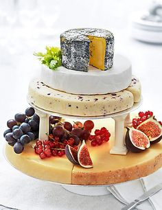 Alternative wedding cakes - made of cheese. Small Cheese Celebration Cake Food at M & S. Cheese Table, Cheese Platters, Traditional Wedding Cake, Traditional Cakes, Antipasto, Wedding Cakes Made Of Cheese, Cheese Tower, Wheel Cake, Best Cheese