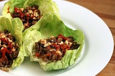 Asian Turkey Lettuce Wraps  Servings: 20 half cup servings  Ingredients  2 tablespoon canola oil  3 pounds ground turkey breast  1-1/2 inch piece fresh ginger, peeled (1 tablespoon minced)  3 garlic cloves (1 tablespoon minced)  4 medium carrots  10 green onions (white and green parts);  1 (8 oz) can sliced water chestnuts  1 (8 oz) can bamboo shoots  1 c hoisin sauce  1/2 c soy sauce  1/3 c dry sherry  1 T sesame oil  1 T Sriracha or other hot chili sauce or past