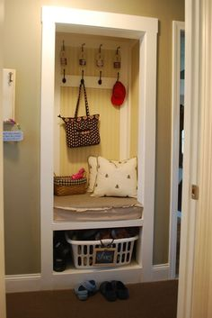 Closet into a Mudroom - this is such a smart idea.  I wonder if this would work in a linen closet - say the one at the top of my stairs?  The kid could leave all her bags, coats, umbrellas, etc. up there!!