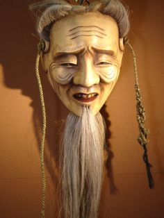 One of a selection of Japanese masks - CARO10085 - available to hire.