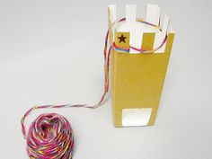 Knitting with juice/milk pack loom.