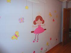 mural infantil niña en columpio mariposas y flores de colores