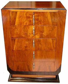 This is a superb 1930's Art Deco Walnut chest of 5 drawers with a modernist feel.