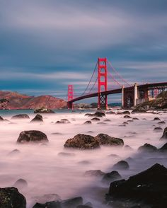 Few views are as breathtaking as #SanFrancisco's #GoldenGateBridge on a clear day. What looks like fog (but is actually waves crashing) hovers along the rocks of Marshall Beach at Golden Gate National Recreation Area in #California, where photographer Bruce Getty (@gettyphotography) shot this captivating image. @goldengatenationalparks -- one of the most visited #nationalparks -- offers spectacular views and a natural oasis in the heart of #SanFran.