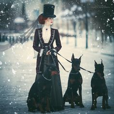 Woman dressed in Victorian clothing (top hat, blouse, jacket, skirt) with doberman dogs in the snow. Women's neo-victorian fashion and clothing inspiration Viktorianischer Steampunk, Costume Steampunk, Steampunk Fashion, Gothic Fashion, Victorian Fashion, Steampunk Emporium, Snow Fashion, Christmas Fashion, Fashion Women