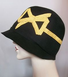 Schiaparelli inspired 20s cloche with braided straw bow.