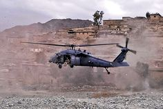 A UH-60 Black Hawk helicopter lands to medically evacuate an Afghan commando injured