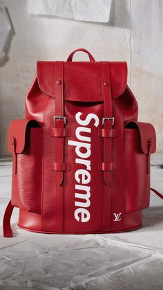 Louis Vuitton Christopher Backpack in Epi leather from Men's Fall Winter 2017 Collection by Kim Jones, in collaboration with Supreme.