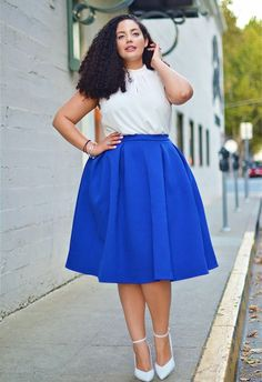 Funnel top tucked into a vibrant blue a-line skirt.