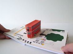 """""""Queue"""" by Chisato Tamabayashi: This book is designed both as a pop-up book but also as a fold-out, full pop-up scene. The book was bound in such a way that one could communicate two different views. Opened as a book, each car appears alone, running free, but opened in full, the cars all add up along the strip of the street //"""