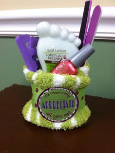 """We TOE-tally appreciate all you do!"" Made 15 of these for volunteer appreciation gifts but forgot to photograph them. Color scheme of others was much better, all shades of lime and plum. This was a leftover...included fuzzy socks, nail polish, foot scrub, pedicure kit items. Total $4 each. Nail Design, Nail Art, Nail Salon, Irvine, Newport Beach"