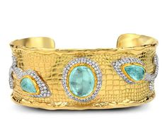 Victor Velyan gold cuff with Paraiba tourmalines and diamonds.