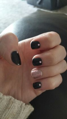 Black nails with rose gold glitter and jewels
