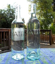 DIY - Wine bottles into water bottles.  Great idea for the table settings.