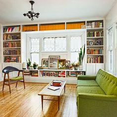 DIY built-ins complement the original windows, and clean-lined furniture brightens the space. | Photo: Conan Fugit | thisoldhouse.com