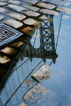 pinterest.com/fra411 #NYC - manhattan bridge puddle reflection