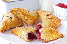 Raspberry Puff Turnovers Close Edit description Tender, flaky pastry enclosing a tart-sweet raspberry filling. Sin Gluten, Turnover Recipes, Flaky Pastry, Filo Pastry, Savory Pastry, Choux Pastry, Raspberry Filling, Raspberry Bush, Raspberry Desserts