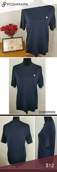 """EUC FILA Women's Navy Blue Work-out Tee FILA Women's Navy Blue Work-out Tee  Approx. Laid flat Measurements: Pit to Pit - 19"""" Length - 26 1/2"""" - Scoopneck  - tag free - 100% polyester  - in EXCELLENT pre-owned CONDITION.  No holes/rips. No stains/marks. Non-smoking home. Feel free to ask. Fila Tops Tees - Short Sleeve"""