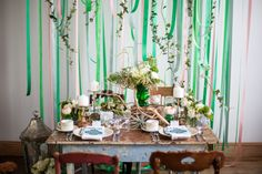 Swooning over this St. Patrick's Day-inspired styled shoot. Styled by The Bliss Life and captured by Bernadette Pollard, this emerald-hued tabletop is more about vintage chic than rainbows and leprechauns. Contemporary stationery mixes elegantly with a whimsical ribbon backdrop, natural elements and vases boasting a gorgeous patina, for a pulled together look that is pure gold. #greenweddings #diyweddings #stpatricksday #saintpatricksday #tabletop