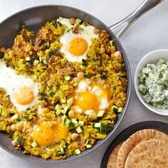 Crack some eggs right on top of this chickpea and potato hash for an easy one-skillet dinner. #DinnerTonight