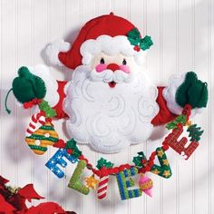 Hanging Felt Applique Home Accent Kit - Bucilla felt applique wall hanging kit Believe in Santa Kit. Kit includes stamped felt, embroidery floss, beads, needles and trilingual instructions Wall Hanging is 20-inch X 17-inch.   Link    #Christmas
